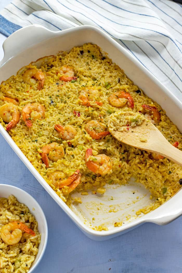 Baked Casserole in white oblong dish with wooden spoon