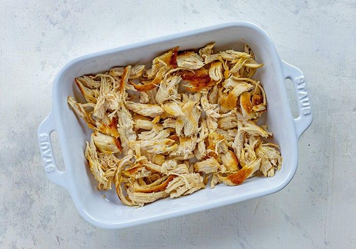 shredded rotisserie chicken in white casserole dish
