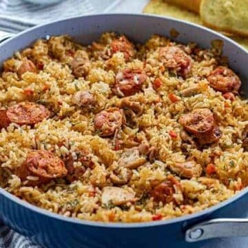 Cooked Chicken and Sausage Jambalaya in pan with toasted french bread on the side