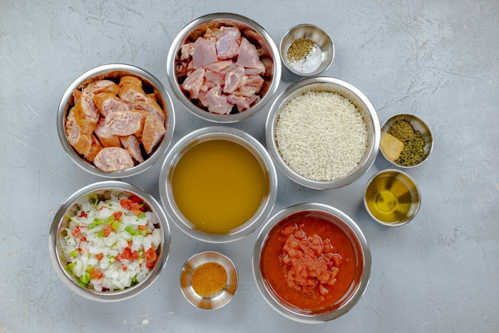 Jambalaya ingredients laid out on counter in small bowls