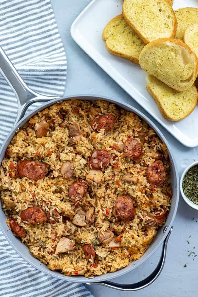 cooked jambalaya in pan with toasted french bread on the side