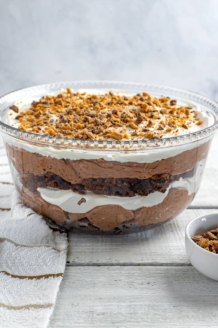 Layered chocolate heath bar trifle in glass bowl