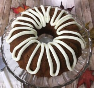moist pumpkin pound cake iced with cream cheese frosting