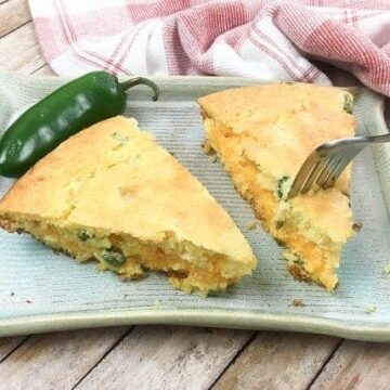 two slices of baked cornbread with fork in one slice