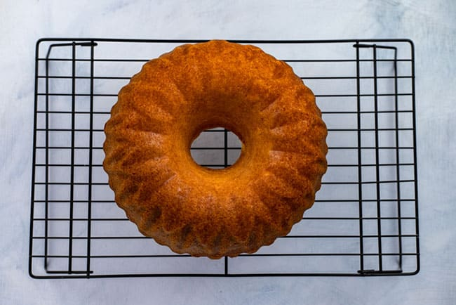 baked bundt cake on cooling rack