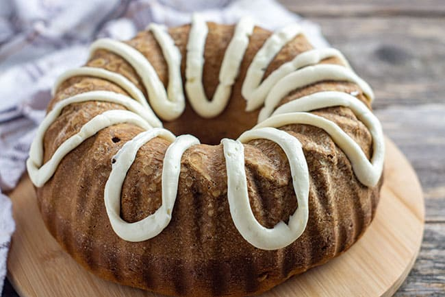 baked pumpkin spice cake with cream cheese fosting