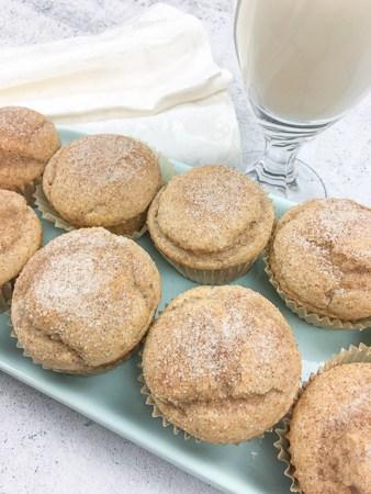 cinnamon applesauce muffins on blue serving platter