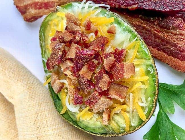 Baked Egg in Avocado with Bacon and Cheese