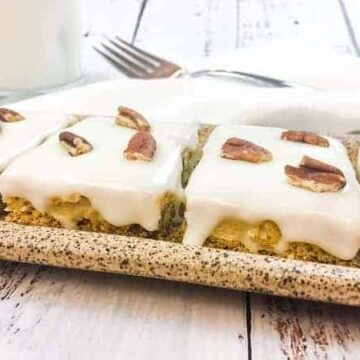 Italian Cream Cake Squares on brown platter