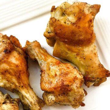 baked lemon pepper wings on white plate