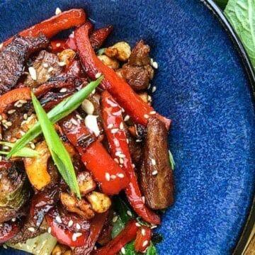 Cashew Pork Stir Fry in blue bowl