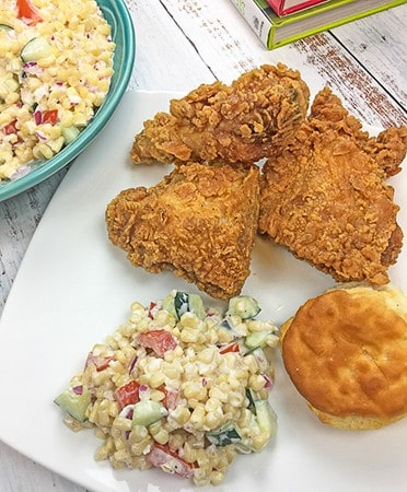 summer corn salad with fried chicken and biscuit