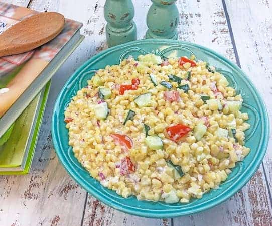 creamy cold corn salad inside teal blue bowl