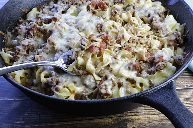 creamy beef pasta bake in cast iron skillet
