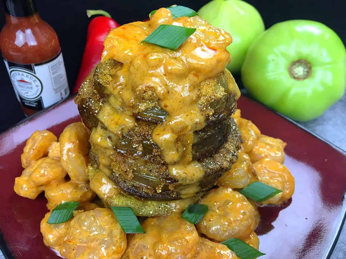 stacked fried green tomatoes with shrimp creole sauce on top