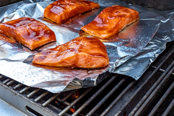 4 salmon fillets on foil on the grill