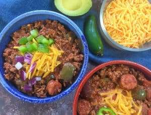 low carb keto chili in serving bowls with toppings