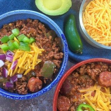 cooked chili in colorful bowls