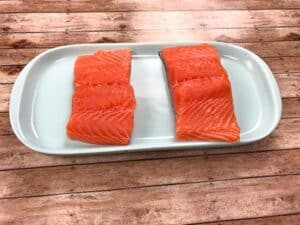 salmon filets on blue plate