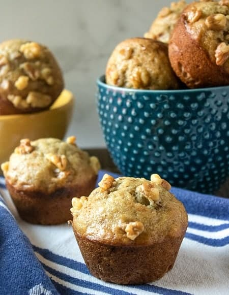 baked muffins on counter and in bowls