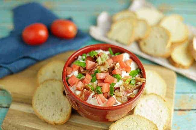 BLT Dip in red bowl with Crostini slices on the side