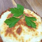 lasagna stuffed portobellos on wooden board
