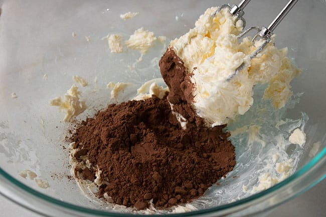 butter and cocoa in mixing bowl