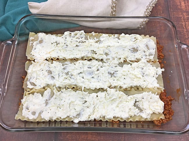 ricotta cheese layer on top of lasagna noodles