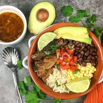 one serving in orange bowl with avocado and toppings