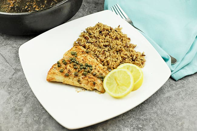 fish with wild rice and lemon slices
