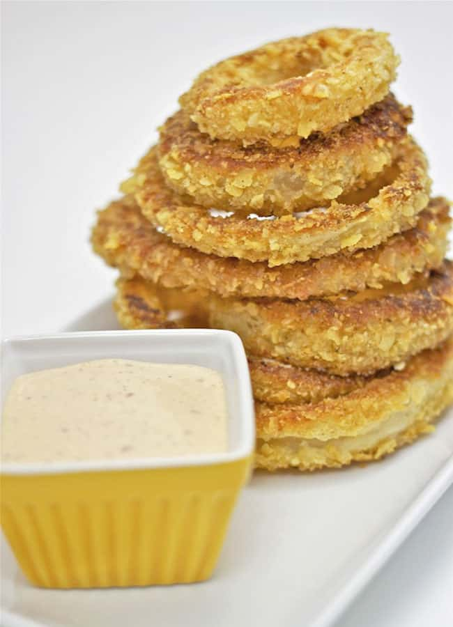 stacked baked onion rings with dipping sauce