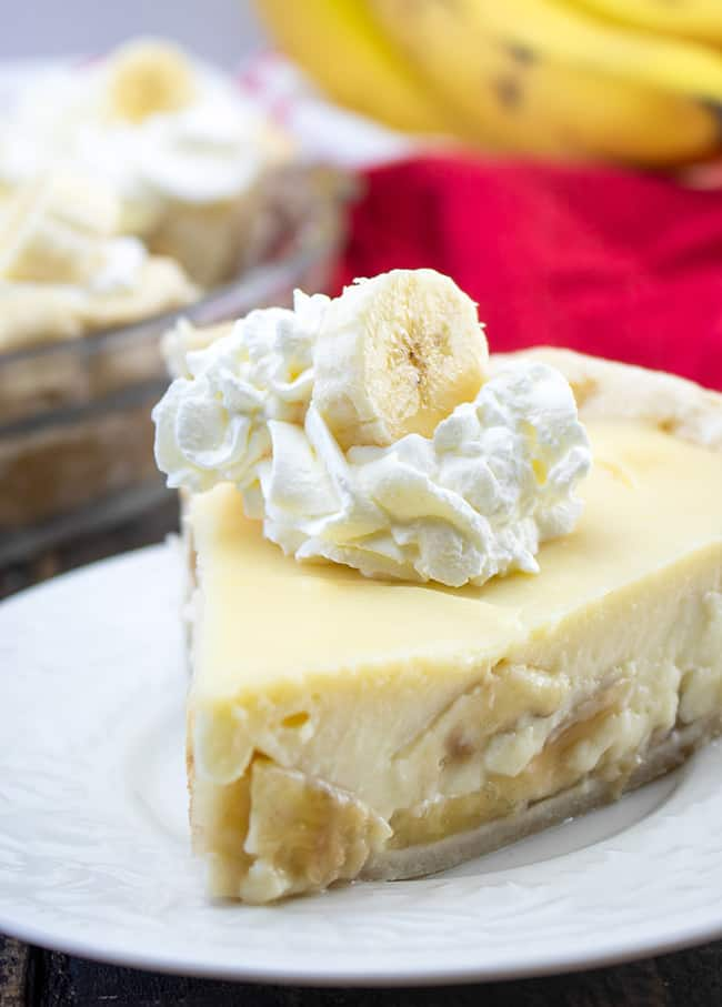 slice of pie with whipped cream and banana slice on top