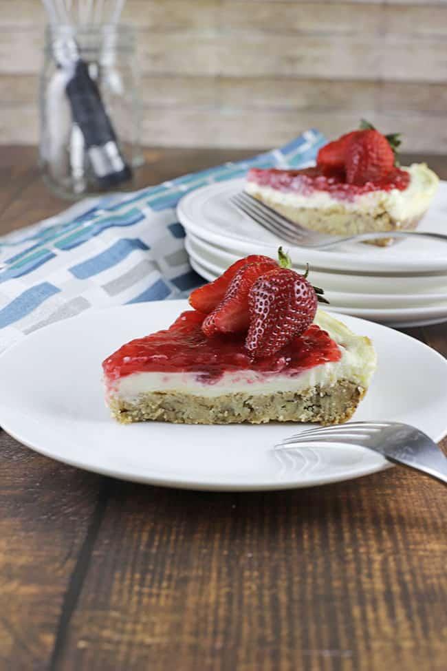 strawberry cheeecake slice with fresh strawberry on top