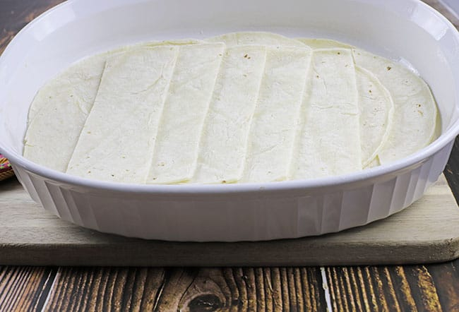 layer of sliced tortillas in casserole dish