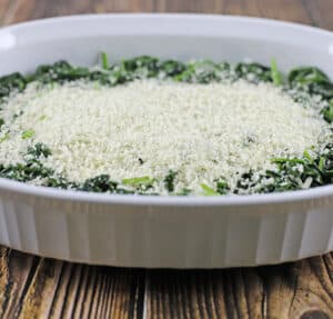 sauteed spinach with panko breadcrumbs on top in baking dish