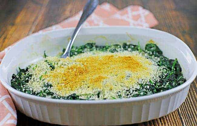 cooked spinach in white casserole dish