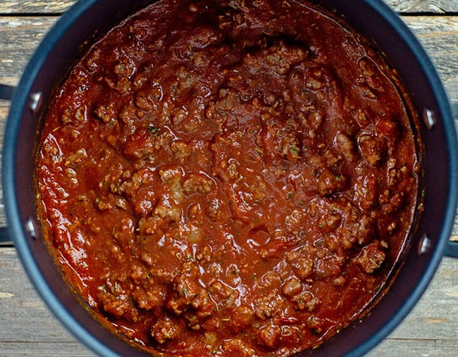 cooked red meat sauce for lasagna in pot