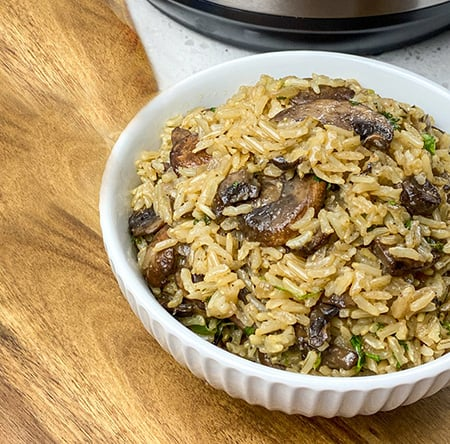 cooked mushroom rice in a white bowl