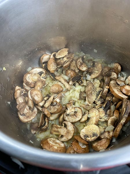 add mushrooms to the pot, saute.