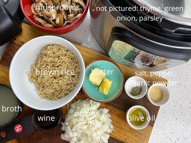 ingredients for mushroom rice on counter top next to Instant Pot
