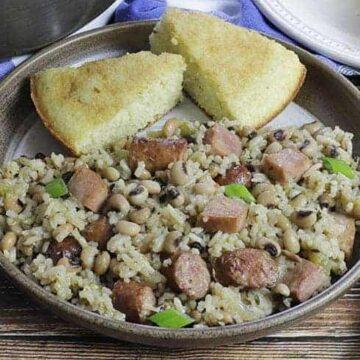 easy blackeye pea jambalaya in plate with cornbread