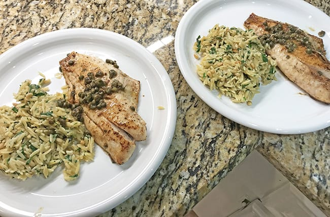 red snapper fillets with lemon butter caper sauce and a mediterranean inspired orzo salad