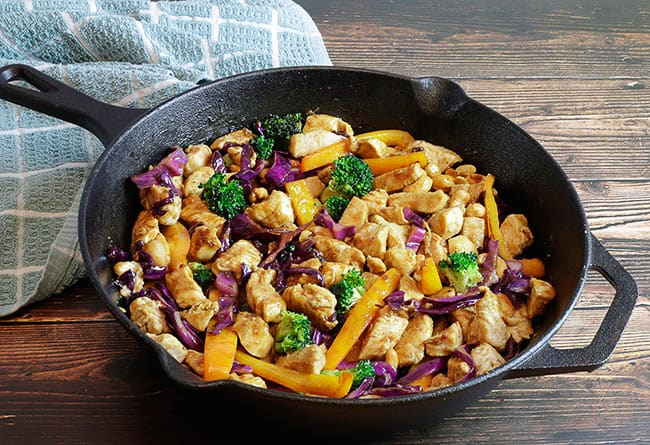 sauteed chicken and vegetables in skillet