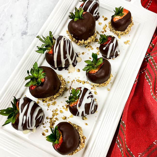 Chocolate Dipped Strawberries decorated with white chocolate and chopped pecans