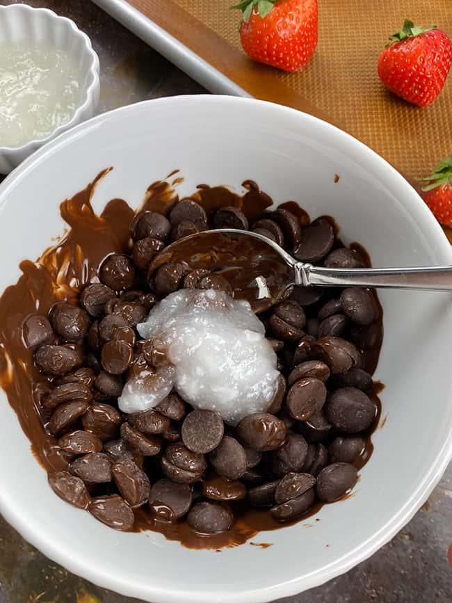 Chocolate chips and coconut oil in bowl