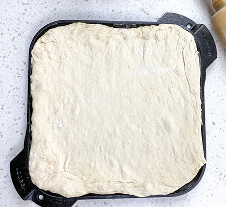 dough rolled out and placed on skillet