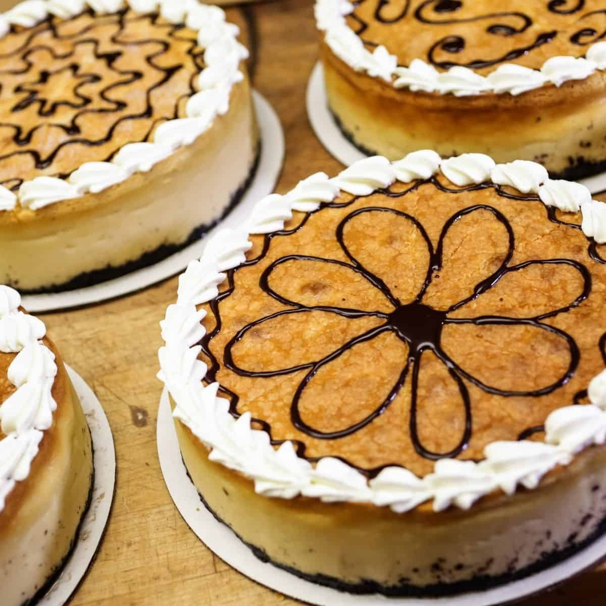 cheesecake decoration ideas cheesecake with swirl of chocolate syrup in shape of a flower with whipped cream around edges