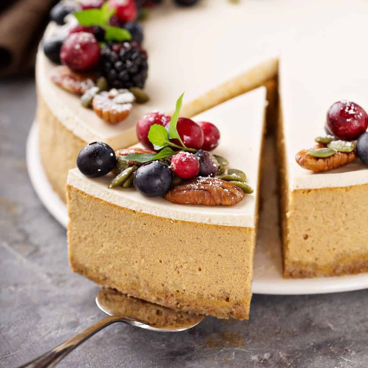 cheesecake topped with nuts and berries