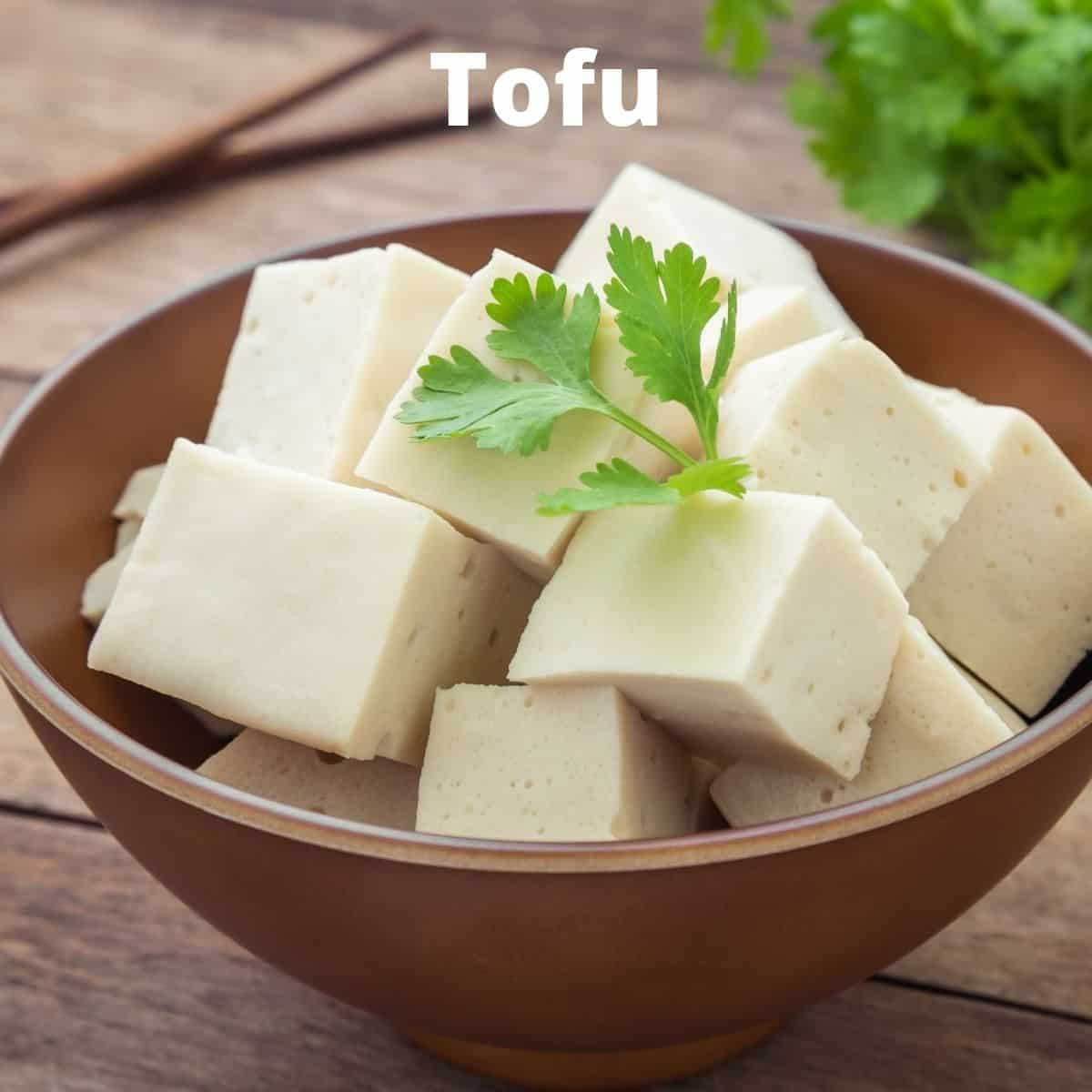 diced tofu in wooden bowl