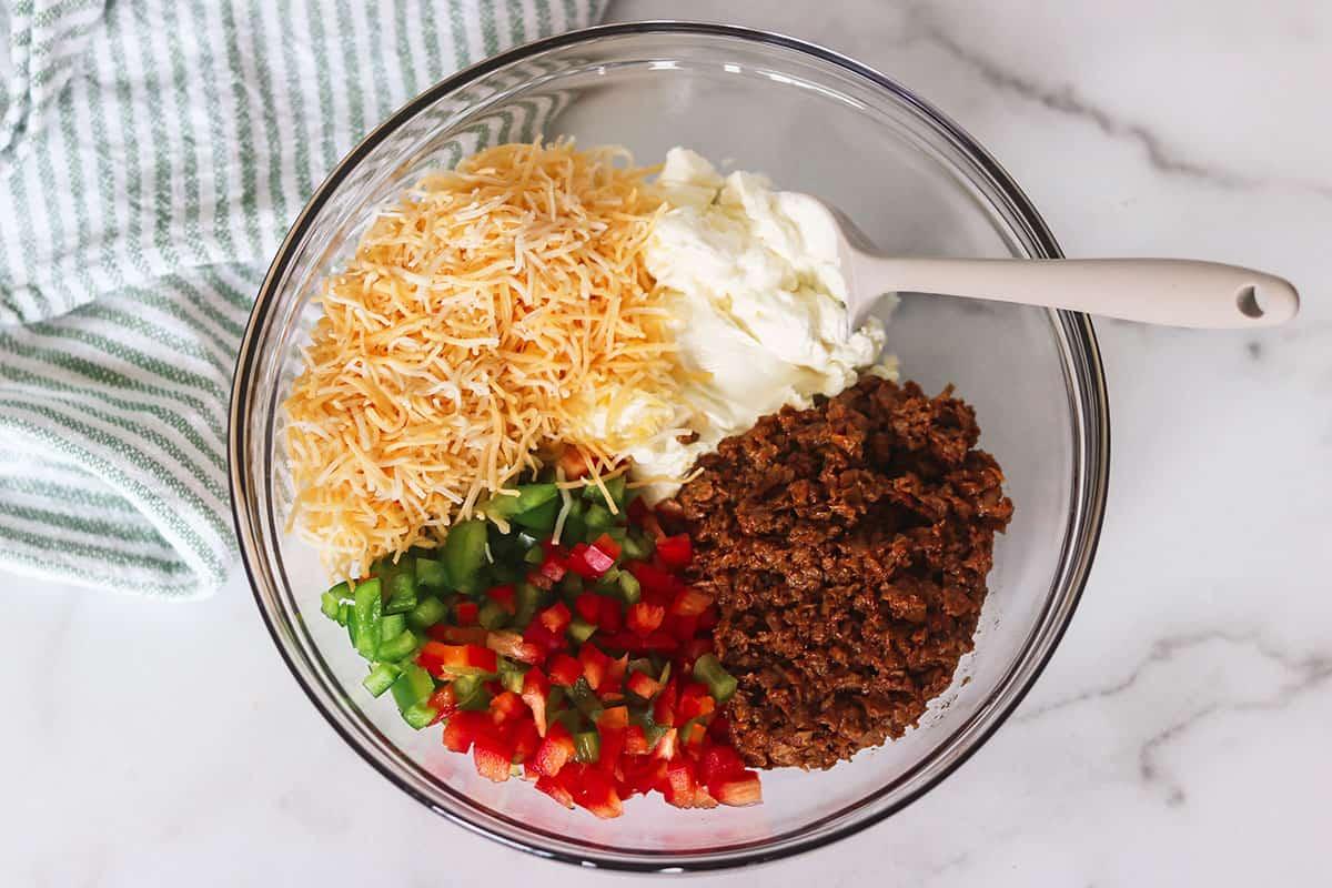 taco pinwheel ingredients in glass bowl
